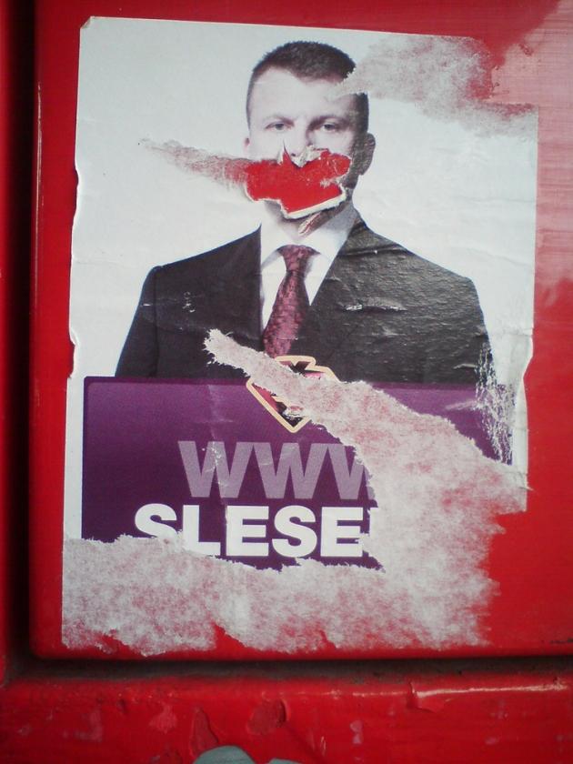 Šlesera plakāts